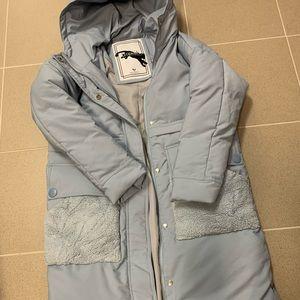 Light blue parka coat with plush detailed pockets